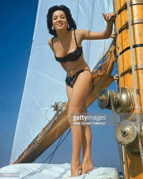 Linda Cristal Argentinian actress wearing a black bikini standing on the deck of a yacht circa 1965