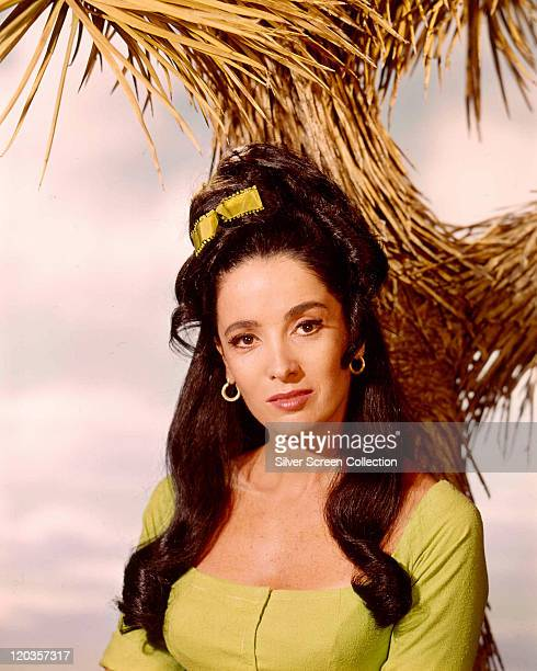 Linda Cristal Argentinian actress with a yellow bow in her hair in a studio portrait against a background of straw issued as publicity for the US...