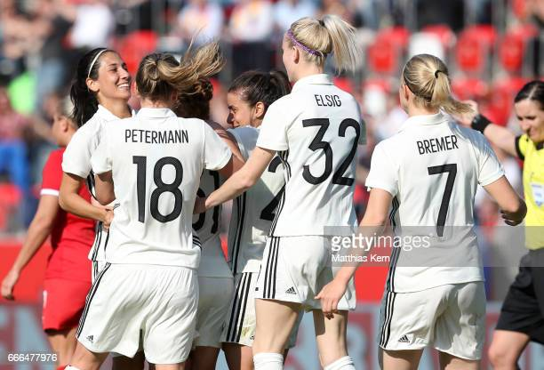 Linda Dallman of Germany jubilates with team mates after scoring the third goal during the women's international friendly match between Germany and...