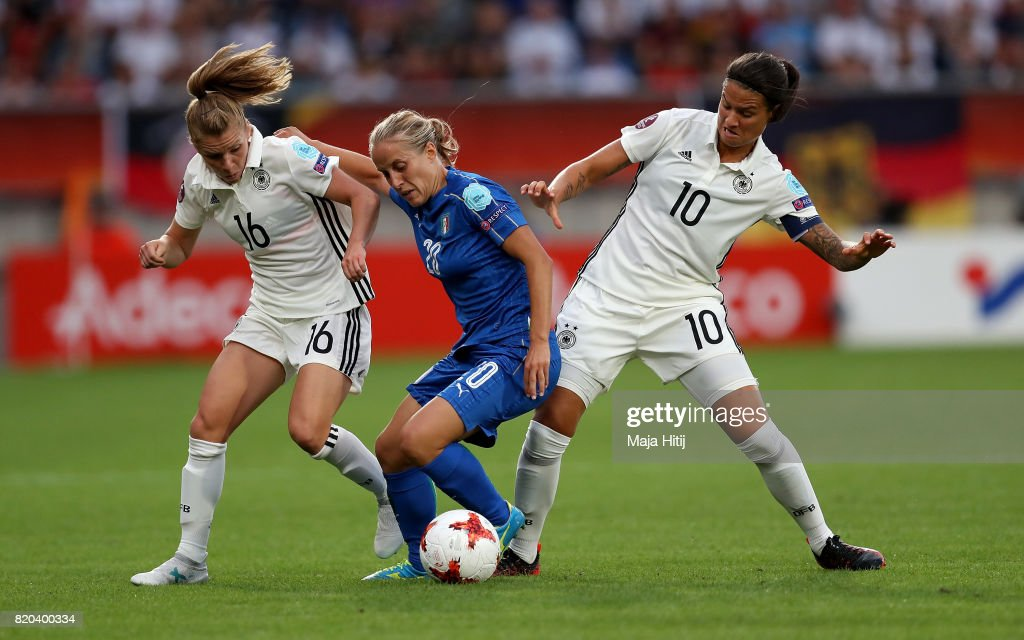 Linda Dallmann (L) and Dzsenifer Marozsán of Germany and Valentina Cernoia of Italy compete for the ball during the Group B match between Germany and Italy during the UEFA Women's Euro 2017 at Koning Willem II Stadium on July 21, 2017 in Tilburg, Netherlands.
