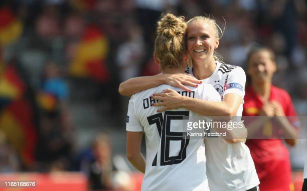 Linda Dallmann celebrates the tenth goal with Turid Knaak of Germany challenges of Montenegro during the Women's EM Qualification match between...