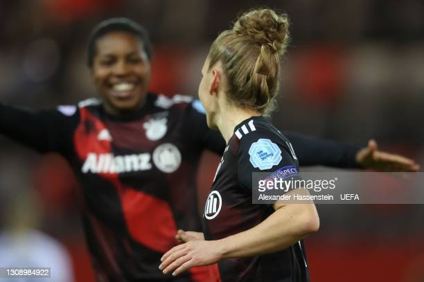 Linda Dallmann of Bayern München celebrates scoring the opening goal with her team mate Lineth Beerensteyn≈ during the First Leg of the UEFA Women's...