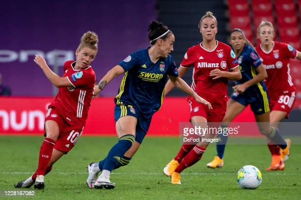 Linda Dallmann of Bayern Muenchen Lucy Bronze of Olympique Lyon and Giulia Gwinn of Bayern Muenchen battle for the ball during the UEFA Women's...