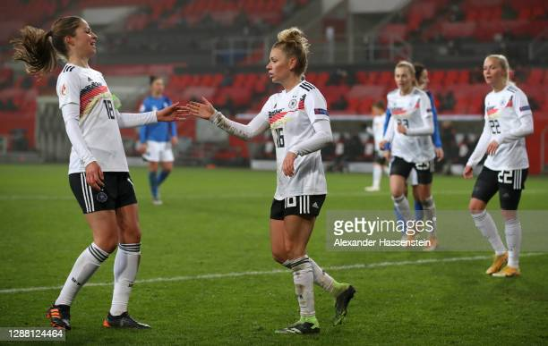 Linda Dallmann of Germany celebrates with Melanie Leupolz after scoring her sides fifth goal during the UEFA Women's EURO 2022 qualifier match...