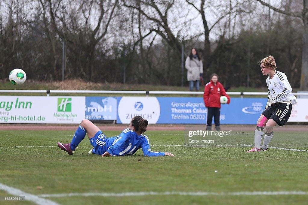 Linda Dallmann of Germany scores their first goal past Triantafyllia Kyriazi of Greece during the Women's UEFA U19 Euro Qualification match between U19 Germany and U19 Greece at Sportzentrum Sued on April 6, 2013 in Kirchheim, Germany.