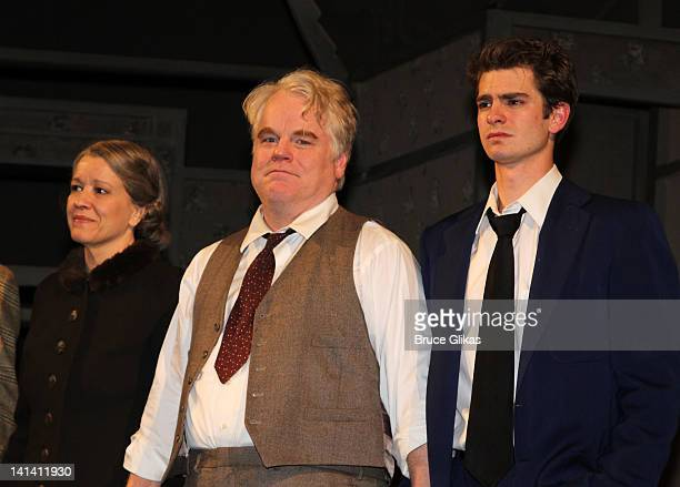 Linda Emond Philip Seymour Hoffman and Andrew Garfield take the Opening Night Curtain Call for Death Of A Salesman at The Barrymore Theatre on March...