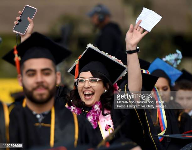 Linda Esparza waves to the crowd during graduation ceremonies for engineering students at Cal State University Long Beach in Long Beach on Tuesday...