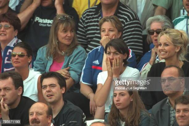 Linda Evangelista and Adriana Karembeu surrounded by supporters in the stadium in Bruges