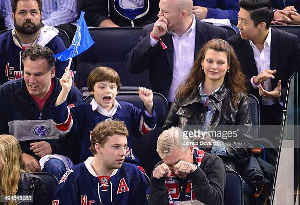 Linda Evangelista and her son Augustin James Evangelista attend Montreal Canadiens vs New York Rangers playoff game at Madison Square Garden on May...
