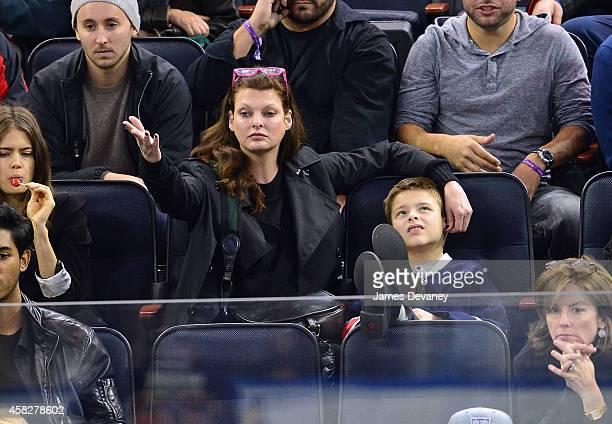 Linda Evangelista and son Augustin James Evangelista attend New York Rangers vs Winnipeg Jets at Madison Square Garden on November 1 2014 in New York...