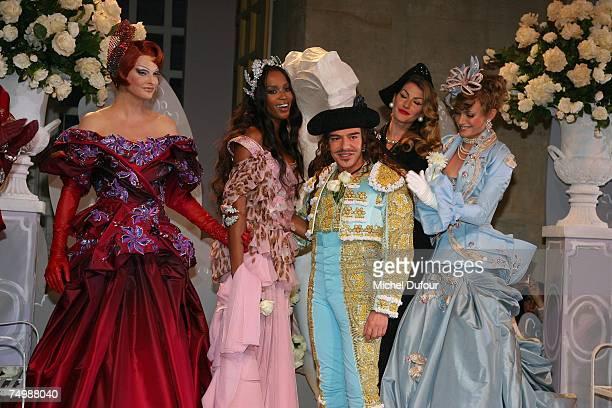 Linda Evangelista Naomi Campbell John Galliano Amber Valletta walk down the catwalk during the Christian Dior Fashion show as part of Paris Haute...
