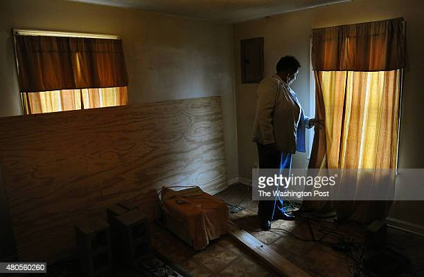 Linda Fay EngleHarris in her home that has ceiling and floor damage She suspects that the floor damage was caused by flooding related to a street...