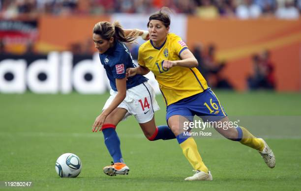 Linda Forsberg of Sweden and Louisa Necib of France battle for the ball during the FIFA Women's World Cup 2011 3rd place playoff match between Sweden...