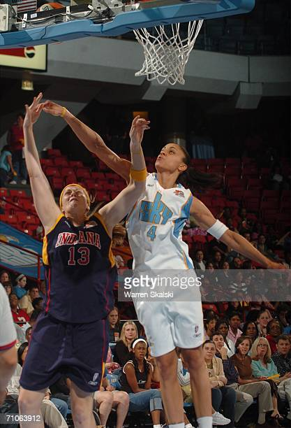Linda Frohlich of the Indiana Fever and Candice Dupree of the Chicago Sky go for the rebound on May 26 2006 at the UIC Pavilion in Chicago Illinois...