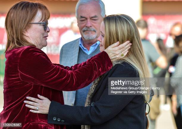 Linda Greene left and her husband John Greene center greet Haylee Holmes outside Angel Stadium before a memorial service for the Altobelli family in...
