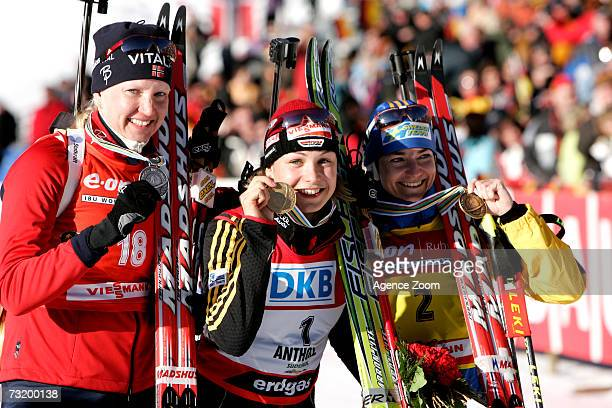Linda Grubben of Norway second place Magdalena Neuner of Germany first place and Anna Carin Olofsson of Sweden third place pose after the IBU...