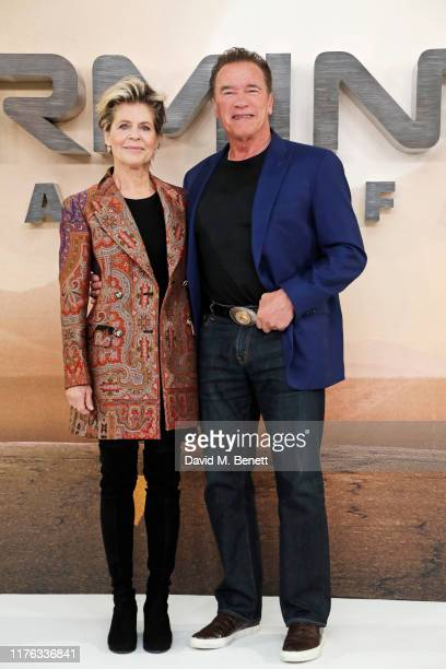 Linda Hamilton and Arnold Schwarzenegger pose at a photocall for Terminator Dark Fate at the Mandarin Oriental Hotel on October 17 2019 in London...