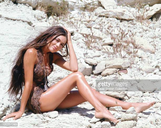 Linda Harrison, US actress and model, in costume sitting on a rocky surface in a publicity portrait issued for the film, 'Planet of the Apes', USA,...