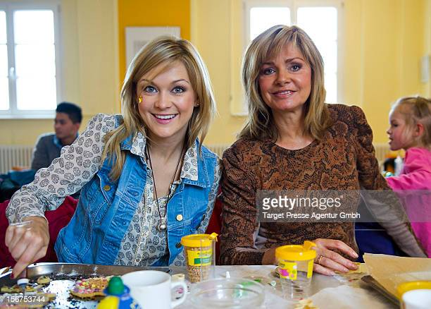 Linda Hesse and Maren Gilzer attend the Celebrity Charity Cooking with children at the CJD on November 20, 2012 in Berlin, Germany.