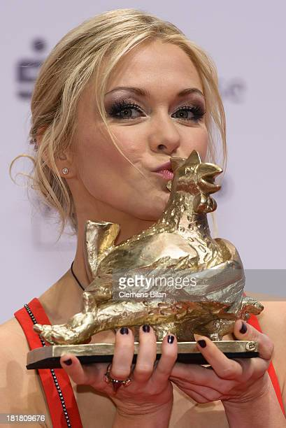 Linda Hesse poses with her award at the Goldene Henne 2013 awards at the Stage Theater on September 25 2013 in Berlin Germany