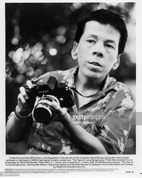 Linda Hunt looks to take a photograph in a scene from the MGM movie The Year of Living Dangerously circa 1982