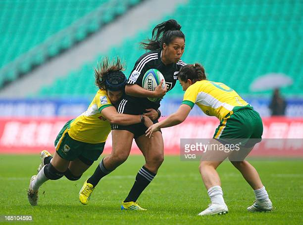 Linda Itunu of New Zealand Women's Sevens team makes a break in the match against Brazil during the third round of the IRB Women's Sevens World...