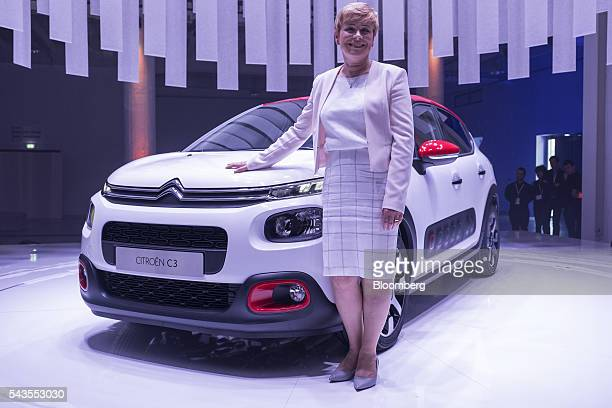 Linda Jackson chief executive officer of Citroen a unit of PSA Peugeot Citroen poses for a photograph beside a new version of the Citroen C3...