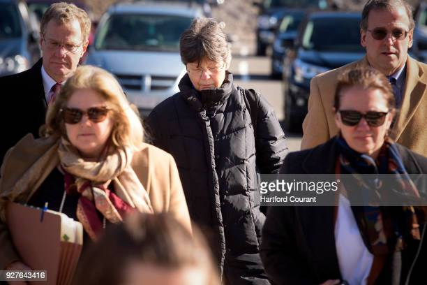 Linda L KosudaBigazzi middle accused of murdering her husband Pierluigi Bigazzi arrives at Bristol Superior Court for arraignment flanked by her...