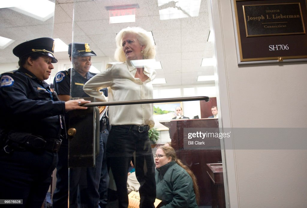 Linda Larson, one of several protesters who occupied Sen. Joe Lieberman's office in the Hart Senate Office Building to voice their opposition to his stand on health care reform, is arrested by U.S. Capitol Police on Thursday morning, Nov. 4, 2009.