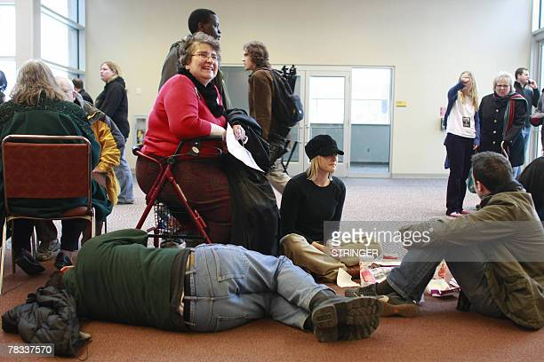 Linda LohseLange waits in line for tickets while her son Marshall LohseLange catches a nap before a rally for Democratic presidential hopeful Barack...