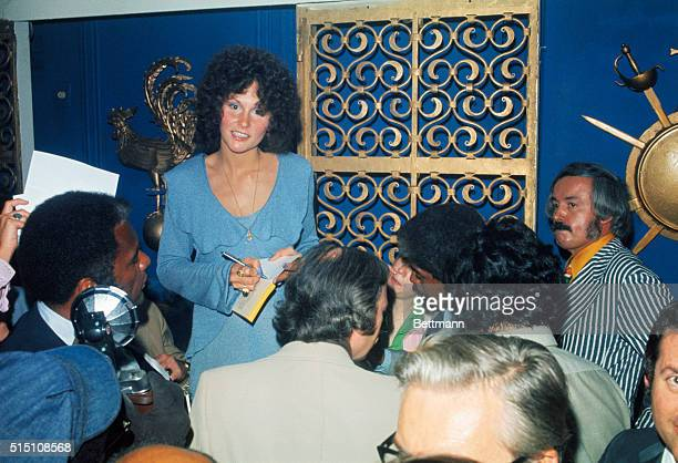 Linda Lovelace , the star of the X-rated movie Deep Throat, is shown answering questions in her New York City hotel room.