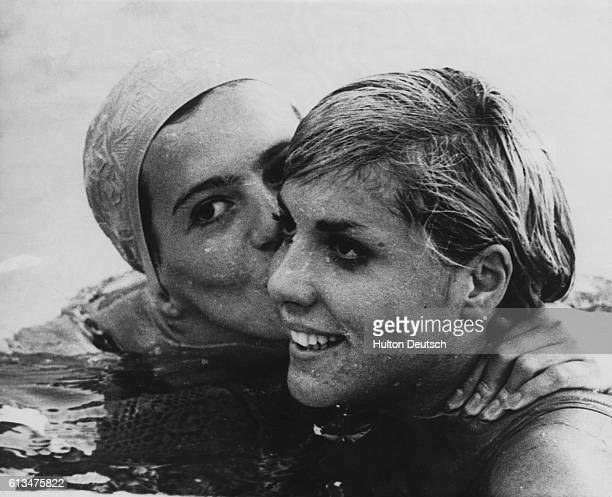 Linda ludgrove on left congratulates Christine Caron of France after their great race in the 100m backstroke final at the European Swimming...
