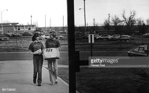 Linda Malpiede left senior at Alameda High School and Doug Hock junior at Pomona High School bring boxtop collection for trampolin Credit Denver Post