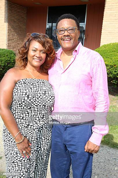 Linda Mathis and husband Judge Greg Mathis posing at Mathis Community Center on July 26 2015 in Detroit Michigan