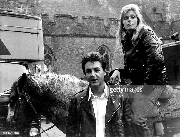 Linda McCartney atop her appoloosa horse poses with Paul for photographs in front of a castle near Dover