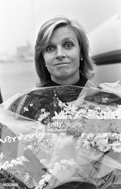 Linda McCartney gets off a private jet at Schiphol Airport holding a bouquet of flowers on December 1st 1987 in Amsterdam Netherlands