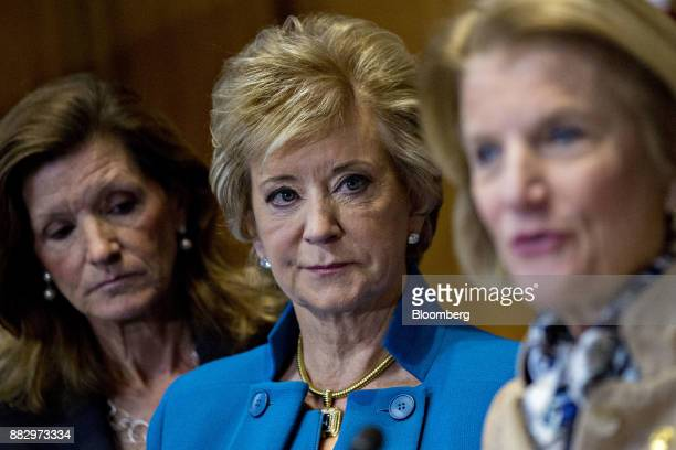 Linda McMahon, administrator of the Small Business Administration , center, listens as Senator Shelley Moore Capito, a Republican from West Virginia,...