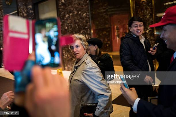Linda McMahon, former CEO of World Wrestling Entertainment , exits after speaking to reporters at Trump Tower, November 30, 2016 in New York City....