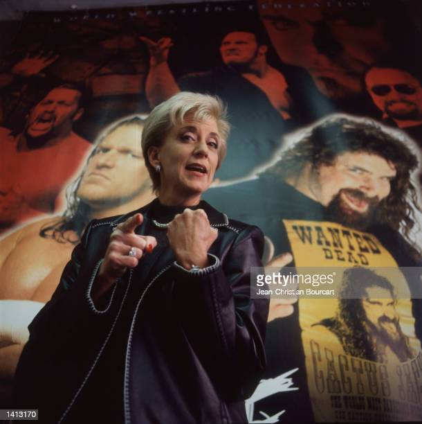 Linda McMahon, President and CEO of the World Wrestling Federation, poses for a portrait with the federation posters in the background December...