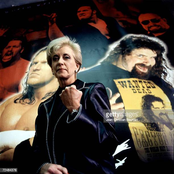 Linda McMahon, President and CEO of the World Wrestling Federation poses for a portrait with the federation posters in the background,December...