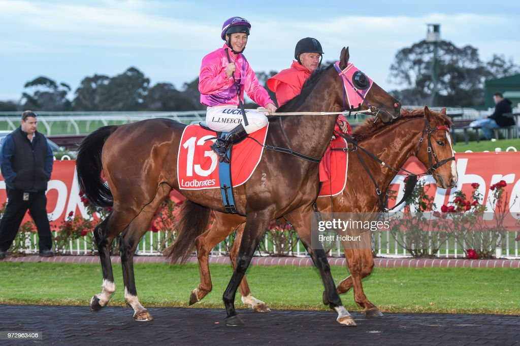 Linda Meech returns to the mounting yard on Wenner after winning the Ladbrokes Protest Payout Handicap at Ladbrokes Park Hillside Racecourse on June 13, 2018 in Springvale, Australia.