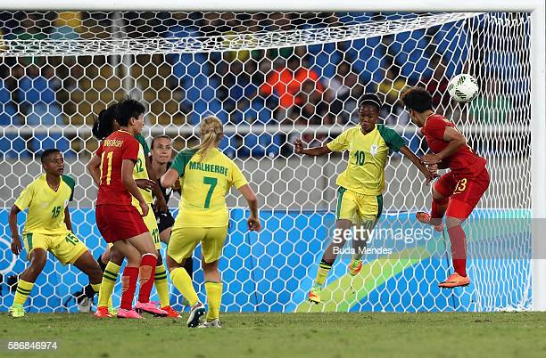 Linda Motlhalo of South Africa and Fengyue Pang of China jump for the ball during the Women's Group E first round match between South Africa and...