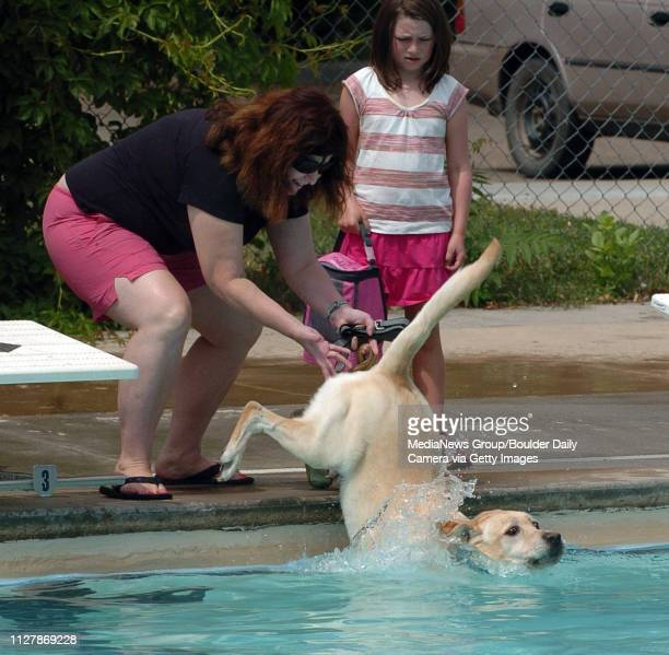 Linda Myers had to give Oliver the dog a little help getting in the poolDogs and owners were able to have some wet fun during Dog Dayz at Scott...