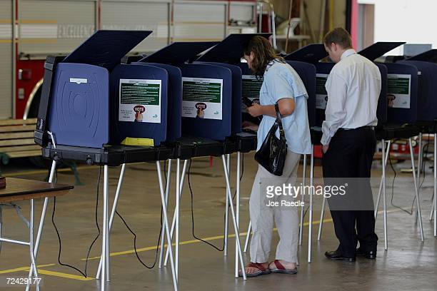 Linda Oldenburg and Paul Duffy cast their votes on Election Day November 7, 2006 in Miami, Florida. Mid-term elections take place across the United...