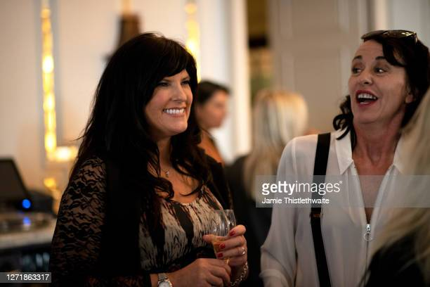 """Linda Olsen smiles during the """"Henpire"""" podcast launch event at Langham Hotel on September 10, 2020 in London, England."""
