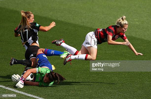 Linda O'Neill of the Wanderers collides with Lauren Brown of the Jets and Jets goalkeeper Eliza Campbell during the round six ALeague match between...