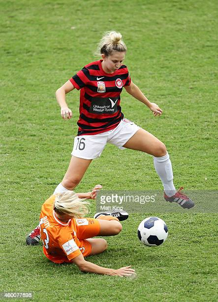 Linda O'Neill of the Wanderers jumps over Tameka Butt of the Roar during the round 12 W-League match between Western Sydney Wanderers and Brisbane...