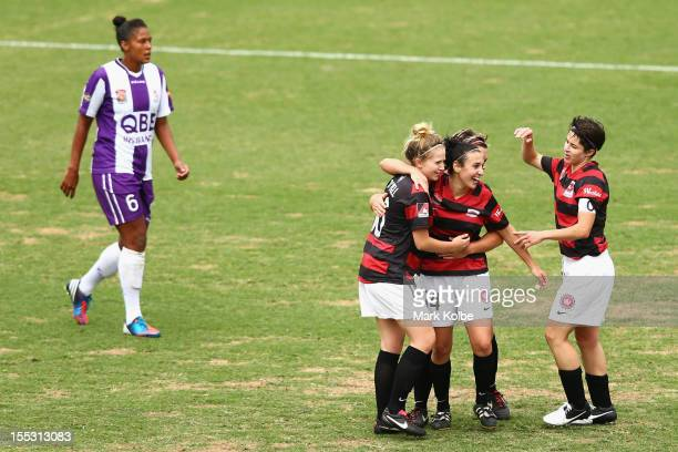 Linda O'Neill, Trudy Camilleri and Sarah Walsh of the Wanderers celebrate after Camilleri scored a goal during the round three W-League match betweeh...
