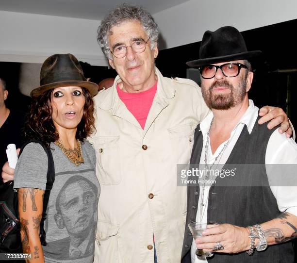 Linda Perry Elliott Gould and Dave Stewart attend the 'Dave Stewart Jumpin' Jack Flash The Suicide Blonde' photo exhibition at Morrison Hotel Gallery...