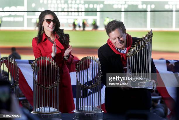 Linda Pizzuti Henry and Tom Werner place the fourth World Championship trophy next to the other three championship trophies the team has won during a...